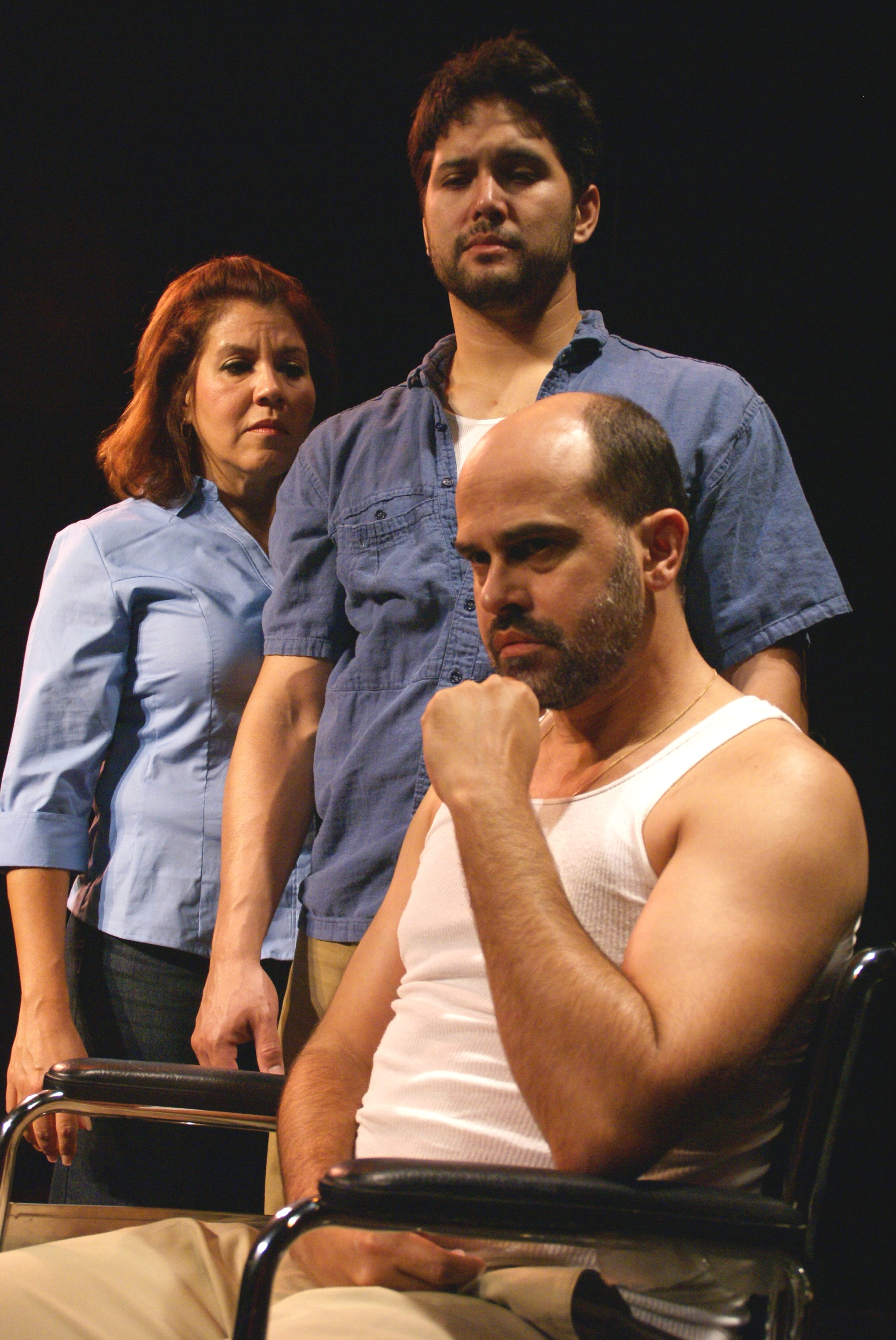 Evelyn Perez and Charles Sother try to comfort Ricky J. Martinez in NewTheatre's production of Nilo Cruz's A Bicycle Country / Photo by Eileen Suarez