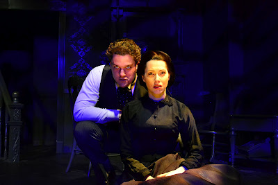 William Matthew Chizever menaces Katherine Amadeo in Naked Stage's The Turn of the Screw