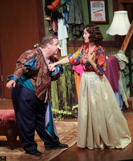 Ken Clement and Michelle Foytak as two aging thespians have a rare harmonious moment in costume for Cyrano de Bergerac in Broward Stage Door's Moon Over  Buffalo