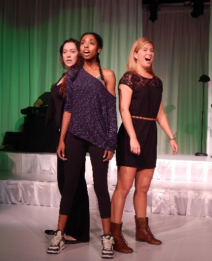 A rehearsal shot of Carla Bordonada, Ziarra Washington and Nicole Kinzel belting out a tune of empowerment in Boca Raton Theatre Guild's Respect, A Musical Journey of Women / Photo by Carol Kassie