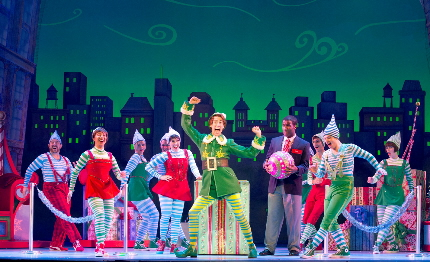Matt Kopec as Buddy leads department store elves in a dance in the national tour of Elf at the Arsht Center / Photo by Joan Marcus