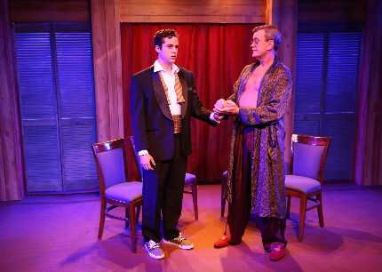 Alexander Zenoz as the impressionable young theater wannabe seeks comfort from Bill Schwartz as the famed director/playwright in  Island City Stage's Secrets of the Trade
