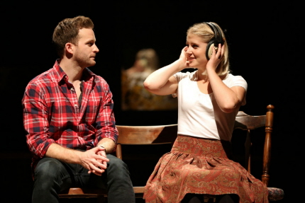 Stuart Ward as Guy and Dani de Waal as Girl listen to some of his music in the national tour of Once / Photo by Joan Marcus
