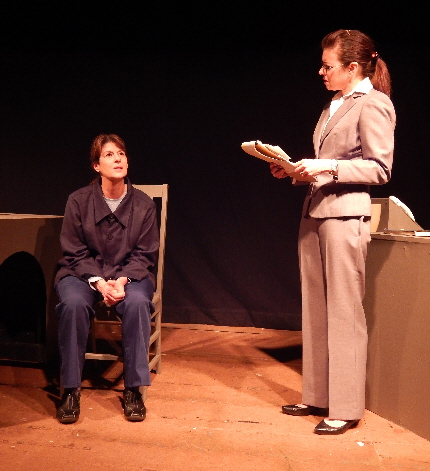 Prisoner Patti Gardner is questioned by inquisitor Jacqueline Laggy in Primal Force's debut production of David Mamet's The Anarchist