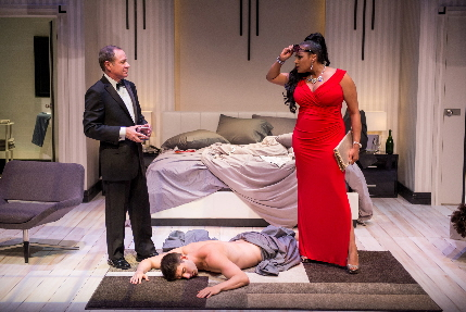 Manager Michael McKeever and fixer Lela Elam discuss what to do with Robert Johnston in the world premiere of Clark Gable Slept Here at Zoetic Stage / Photo by Justin Namon
