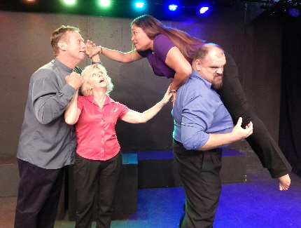 Troy Stanley tries to keep his wife Adela Del Rio from helping Buddhists Todd Caster and Elissa Solomon in Pigs Do Fly's Fifty Plus - A New Attitude