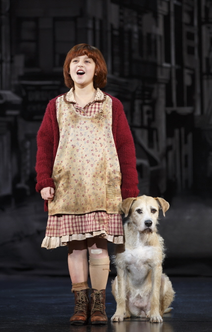 Davie resident 9-year-old Issie Swickle as the title orphan (with accomplished thespian Sunny) in the newly-remounted tour of Annie / Photo by Joan Marcus