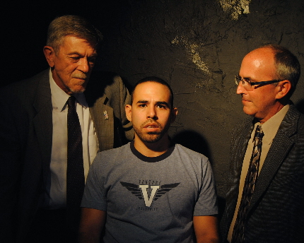 Jim Gibbons and Tim Gore interrogate Rayner Garranchan in Outre Theatre Company's Back of the Throat / Photo by Shannon Ouellette