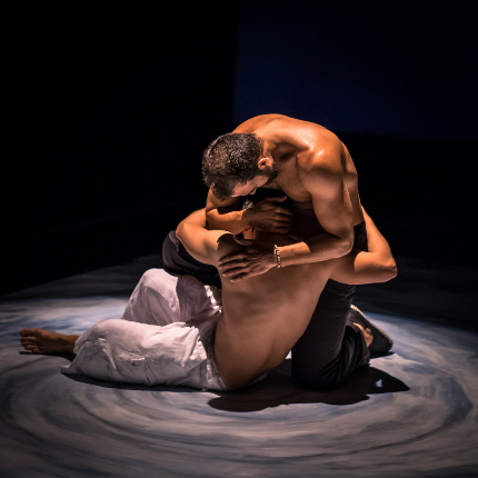 Forrest (Serafin Falcon) embraces his nearly drowned son Aparicio (Andy Barbosa) in Arca Images' production of Nilo Cruz's Hurricane