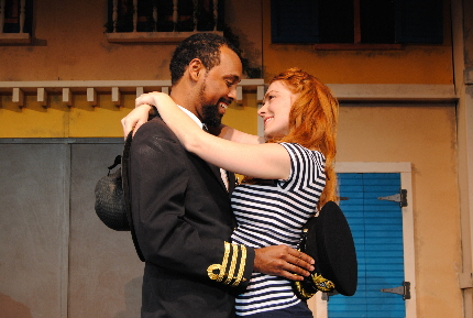 Troy Davidson as Othello in an ephemeral moment of ador with Faiza Cherie as Desdemona in Outre Theatre Company's Othello / Photo by Shannon Ouellettee