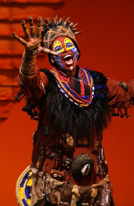 Calling out around the world.... Tshidi Mayne's Rifiki gathers the animals to be dancin' in the street in The Lion King national tour / Photo by Joan Marcus