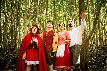 Magan Dee Yantko as Little Red Riding Hood, Bruno Vida as Jack,  Annemarie Rosano as Cinderella and J.J. Caruncho as the Baker go into a decidely Miami forest in a publicity photo for Into The Woods / Photo by Justin Namon
