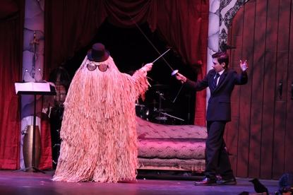 Cousin Itt and Gomez duel for fun in South Plantation High School's production of The Addams Family, a leading Cappie snominee