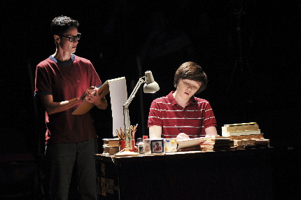 In a reverie, Beth Malone as the older Alison sketches her younger self played by Emily Skeggs in Fun Home / Photos by Joan Marcus