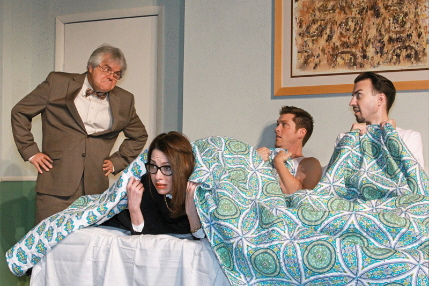 Allan Baker can't quite figure out what is going in in a motel bed among Katherine  Amadeo, Chris Crawford and Cliff Burgess in Unnecessary Farce / Photo by Alberto Romeu