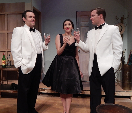 Murderous husband Jason Plourde has what he hopes is a last toast with his wife Gladys Ramirez and her secret lover Roy Lynam in Broward Stage Door's Dial M For Murder