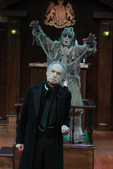 Wayne LeGette as Marley's Ghost spooks Kevin Reilley as the title character in The Trial of Ebenezer Scroioge at Actors Playhouse / Photo by Alberto Romeuo.