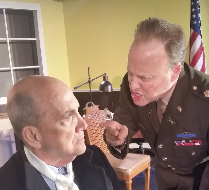 Tony Rein as an Army investigator interrogates Jeffrey Bruce as a German orchestra conductor in Chicken Coop Theatre's Taking Sides