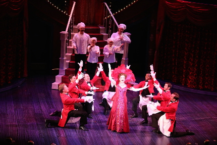 Michele Ragusa leads the boys in the title number of Hello, Dolly! at the Riverside Theatre