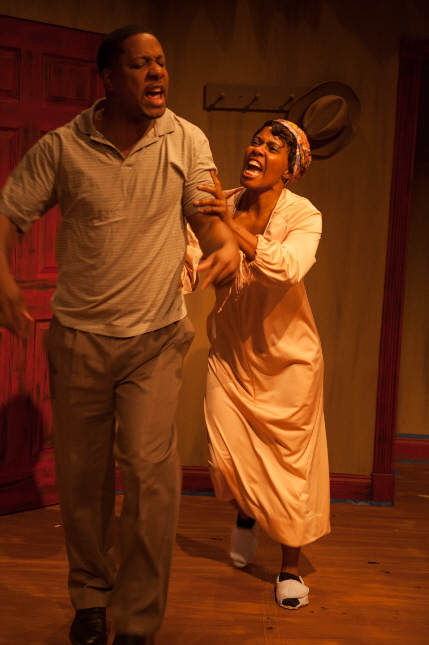 Makeba Pace tries to restrain Ethan Henry in The M Ensemble Company's The Piano Lesson / Photos by