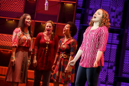 Abby Mueller, right, as Carole King leading a girl group in the national tour of Beautiful - The Carole King story.
