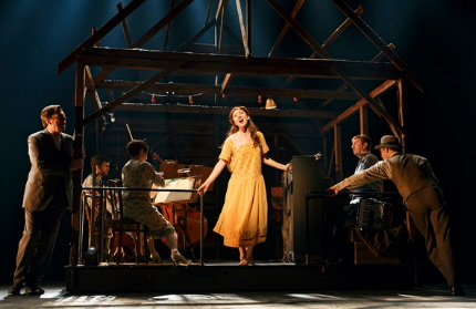 Carmen Cusack leads the ensemble in Bright Star